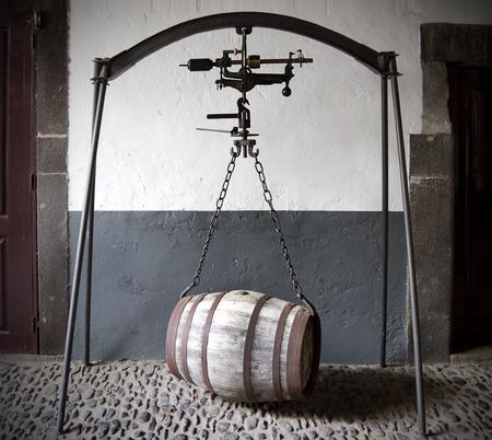 oak barrel: wine barrel hanging from a weight