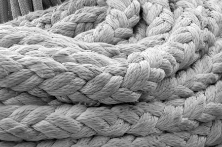 tug boat: old ship ropes sack as black and white Stock Photo