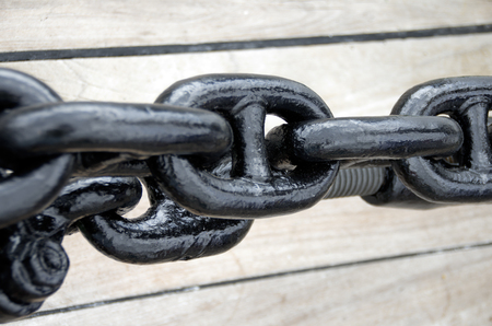 Close up of a rusty anchor chain of a sailboat photo