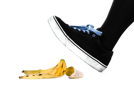 Foot, shoe about to slip on banana peel and have an accident  photo