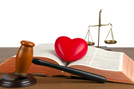 Mallet, legal code, heart and scales of justice. Law concept, studio shots  photo