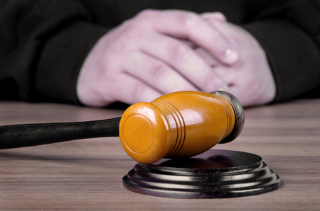 proceeding: Referee hammer and a man in judicial robes in court