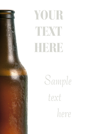 luxuriate: Bottle of beer with drops on white background Stock Photo