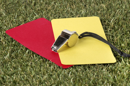 ref: Close-up Of Whistle With Red And Yellow Card On The Field Stock Photo