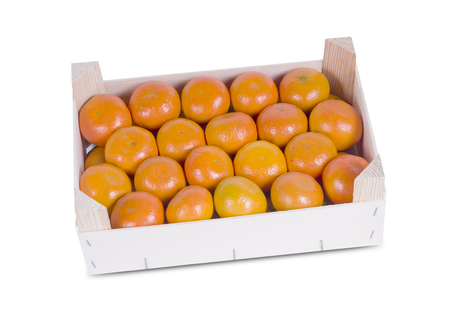 A wood rustic crate full of Clementine Mandarin Oranges. Horizontal format over a white background  photo