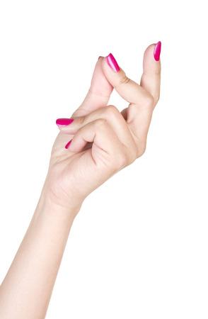 女性の白い背景で隔離の手をスナップ 写真素材