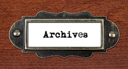 Archives - file cabinet label, bronze holder against grunge and scratched wood Stock Photo