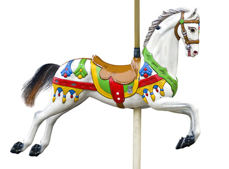 An ancient carousel horse isolated on white
