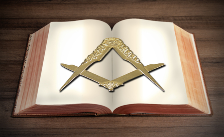 Square and Compass, Masonic symbol on book photo