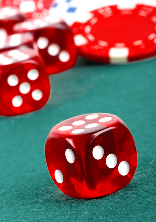 casino table: red dice on a casino table with chips Stock Photo