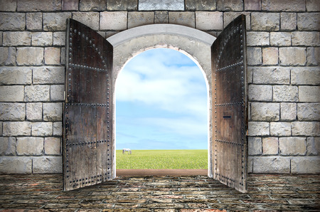 open gate: Beautiful view from arched passage.  Opening to a beautiful cloudy sky Stock Photo