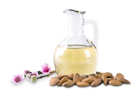 almond oil and almonds with flowers on white background Stock Photo