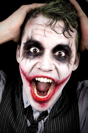 clown nose: Dark creepy joker face screaming angry Stock Photo