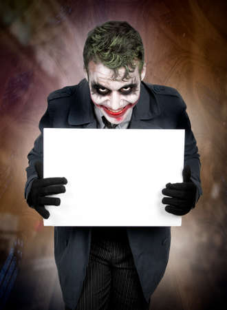 evil clown: Dark creepy joker face screaming angry Stock Photo