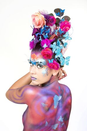fullface: A woman with extreme full-face body painting poses on a white background. Carnival concept