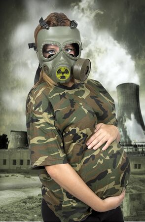 pregnancy: Portrait of 9 months pregnant woman in gas-mask - in toxic environment