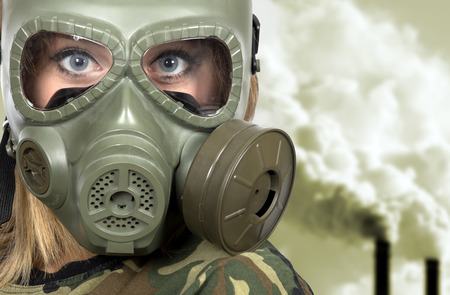 gasmask: Portrait of woman in gas-mask - in toxic environment- pollution concept Stock Photo