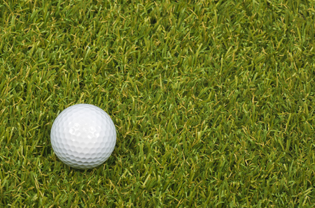 golfball: A Golf ball on course with green grass.