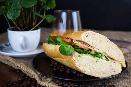 Tasty sandwich on a table in front of a black background Stock Photo