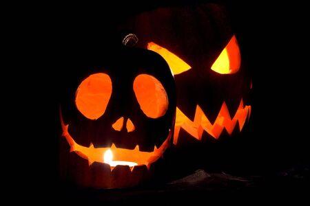 Jack-o-lanterns, two Halloween pumpkins glowing in the night Stock Photo - 597829