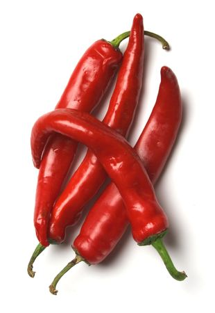 Four red hot chilli peppers on a white background Stockfoto