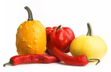 Red and yellow vegetables - little pumpkins, sweet pepper, chili pepper. photo