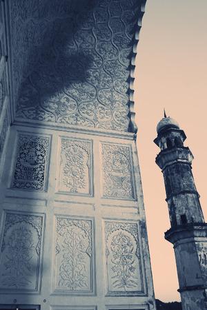 minaret: Minaret of an ancient muslim mausoleum, India. Stock Photo