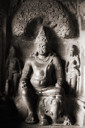 Stone Buddha in an ancient Indian temple. photo