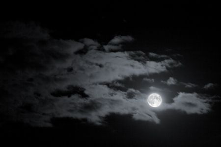 Full Moon glowing in the night, clouds in the sky Stock Photo - 2483974
