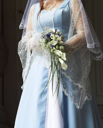Bride in a blue gown holding a bouquet. Stock Photo - 2739199