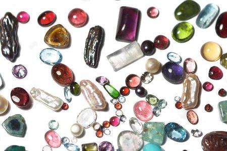 Miscellaneous semi-precious stones on white background. Stock Photo - 2739177
