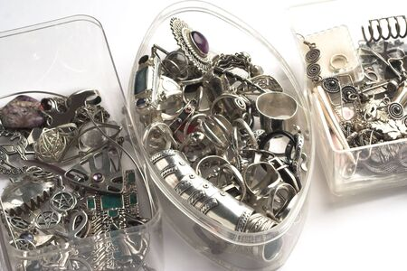 Piles of miscellaneous silver jewelry in transparent boxes. Stock Photo - 2739204