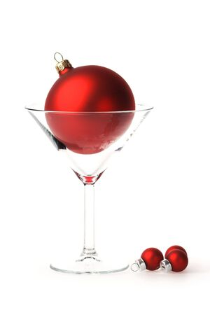 Martini glass with big red bauble in it. Stock Photo