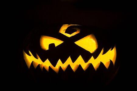 Jack-o'-lantern, spooky Halloween pumpkin face glowing in the night Stock Photo - 5541292