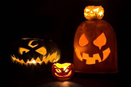 Four Jack-o'-lanterns, Halloween pumpkins glowing in the night. Stock Photo - 5541301