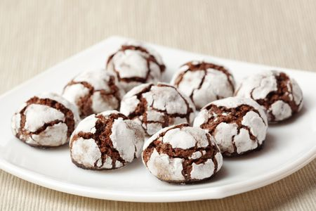 crinkles: Homemade chocolate crinkles on a white square plate, shallow dof. Stock Photo