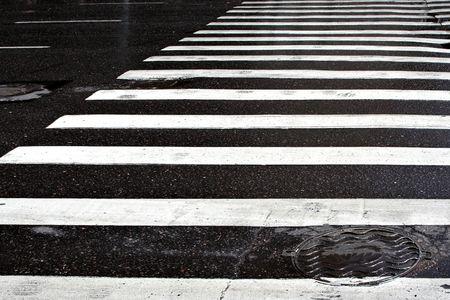 Street crosswalk on a rainy day. photo
