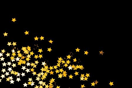 room for text: Golden Christmas stars frame on black background, room for text. Stock Photo