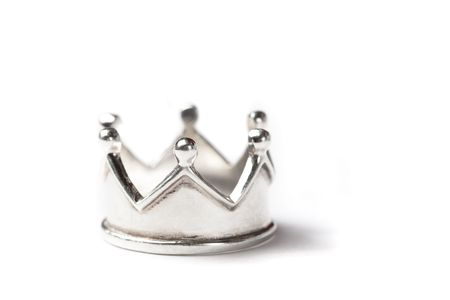 Tiny silver crown isolated on white, shallow dof. Stockfoto