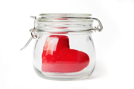 Red plush heart in a jar, lid closed, isolated on white.