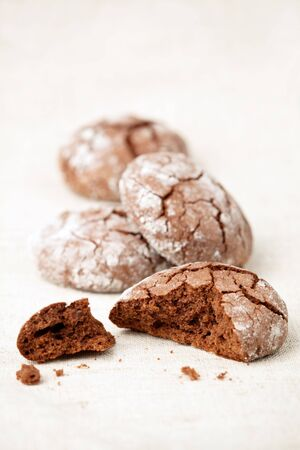 crinkles: Chocolate crinkles cookies on a linen tablecloth, shallow dof. Stock Photo