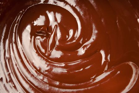 ganache: Close up of melted milk chocolate swirl. Stock Photo