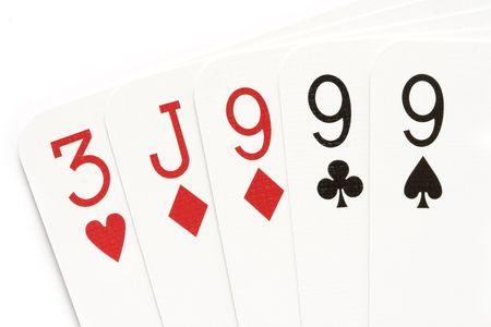 nines: Poker hand - three of a kind on nines.
