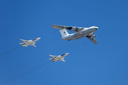 aerobatics: Moscow, Russia, May 9 2009: Russian Air Force airplanes (four-engined aerial refueling tanker Il-78 and attack aircrafts Su-24) imitating aerial refueling at Moscow Victory Parade, 9 of May 2009.