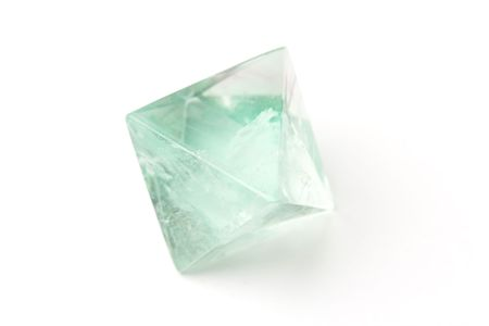 Natural raw fluorite crystal isolated on white. Shallow dof. Stock Photo