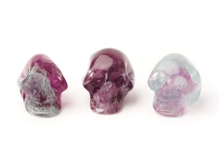 Three hand carved fluorite skulls isolated on white. Stock Photo - 7924350