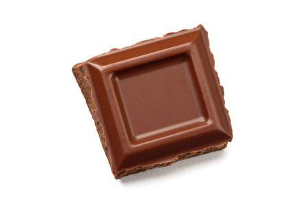 One square piece of chocolate bar, isolated on white.