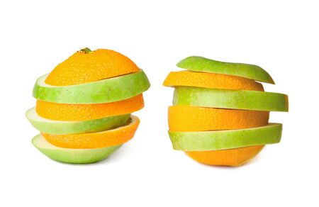 merged: Two sliced oranges and green apples merged together, isolated on white background.  Stock Photo