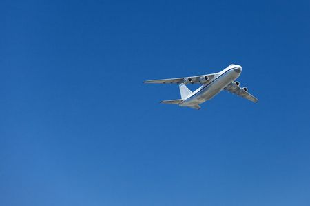 Big airplane in a clear blue sky. Stock Photo - 8017694