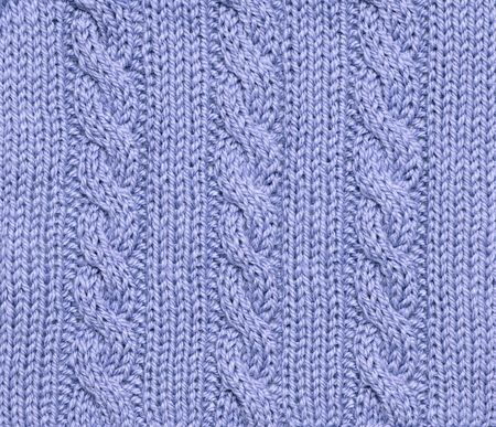 Woolen blue knitted background - winter theme. photo